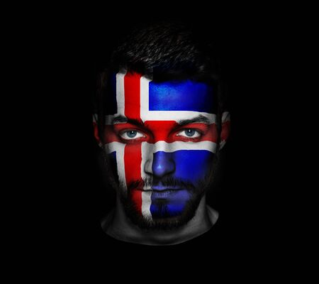 Flag of Island painted on a face of a man.