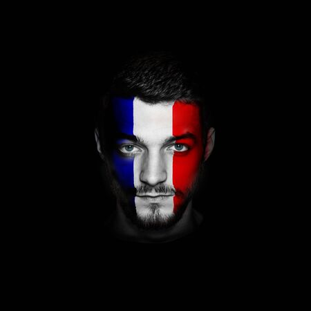 Flag of France painted on a face of a man. Stock Photo
