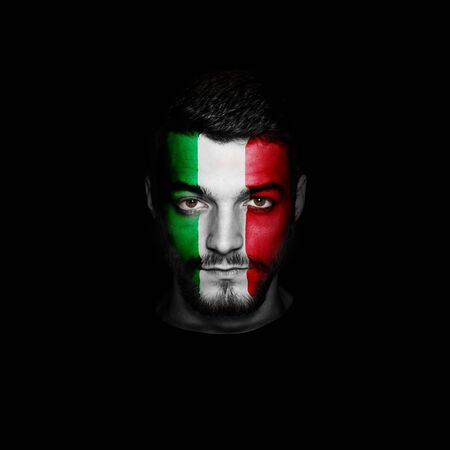 Flag of Italy painted on a face of a man.