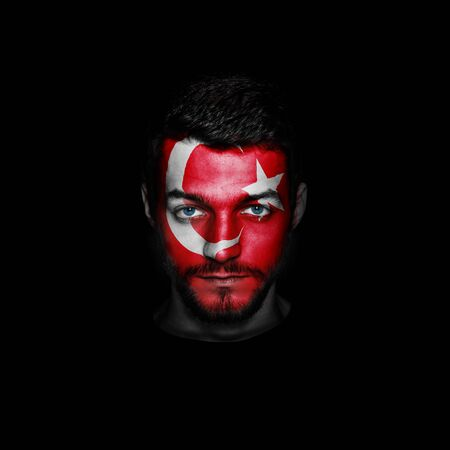 Flag of Turkey painted on a face of a man.