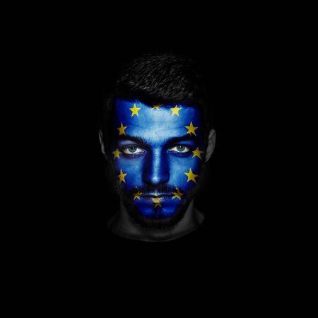 Flag of European Union painted on a face of a man.