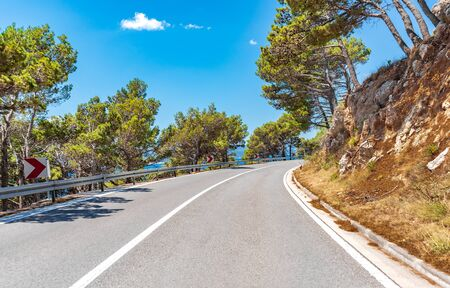 Mountain highway with blue sky.