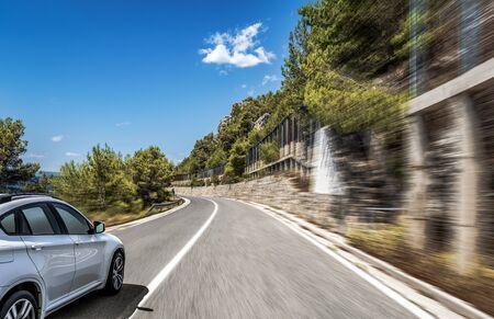 White car rushing through the streets. 写真素材
