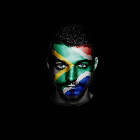 Flag of South Africa painted on a face of a man.