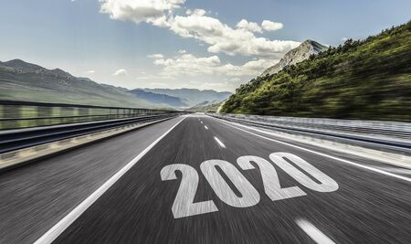 Empty asphalt road and New year 2020. Two thousand and twenty.