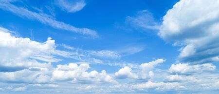 Beautiful sky with white cumulus clouds as a background.