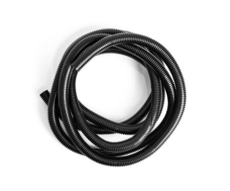 Corrugated plastic hose for electrical wiring on a white background. 版權商用圖片