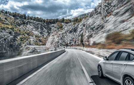 Highway among the mountain scenery. White car on a mountain road.
