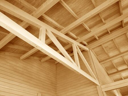 The construction of a wooden roof. Banco de Imagens