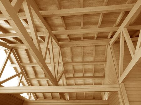 The construction of a wooden roof. Archivio Fotografico