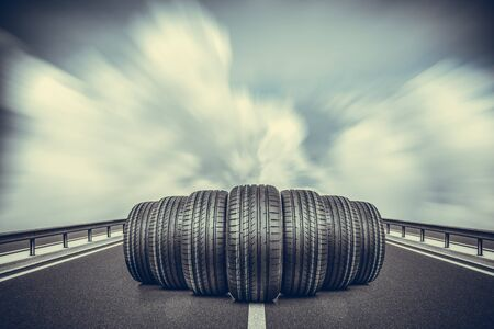 Car tires on an asphalt road.