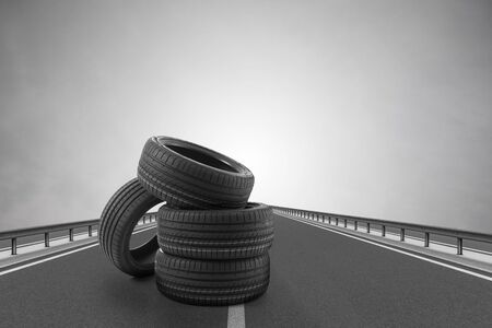 Car tires on an asphalt road.