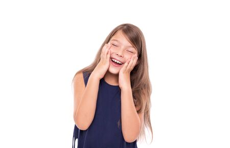 Little girl laughs closing her eyes isolated on a white.