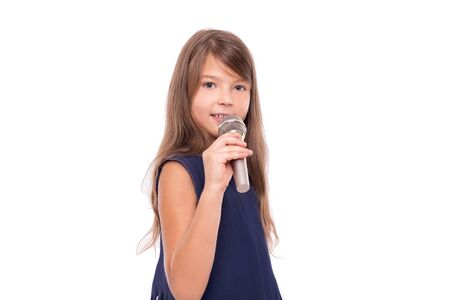 Little girl posing with a microphone for singing on white background.
