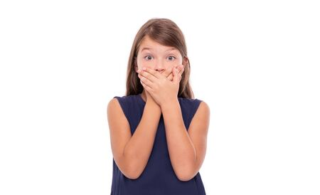 Little girl covered her mouth with her hands. Stock Photo
