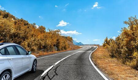Car on the autumn road. Фото со стока - 130134813