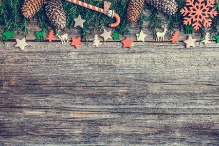 Festive objects of New Year and Christmas on a wooden background. Standard-Bild - 130134824