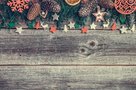 Festive objects of New Year and Christmas on a wooden background. Standard-Bild - 130134823