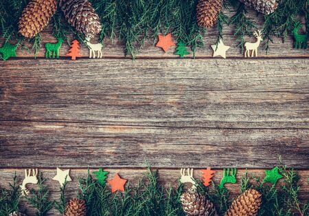 Festive objects of New Year and Christmas on a wooden background. Standard-Bild - 130134826