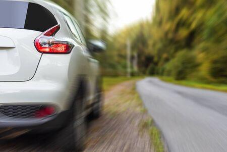 A white car on the road. Reklamní fotografie