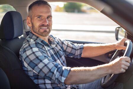 Attractive man driving a car.