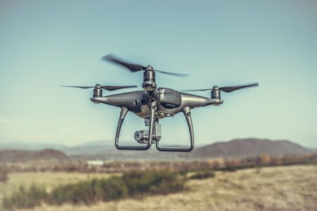 Drone in the air. Stock Photo