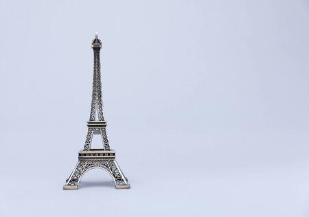 Eiffel Tower on grey background.