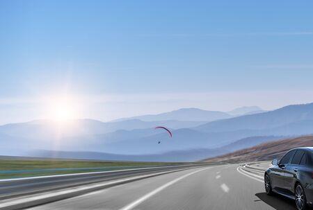 Black car on the highway.