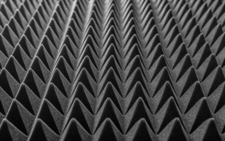 Abstract background in the form of pyramids and dragon scales.