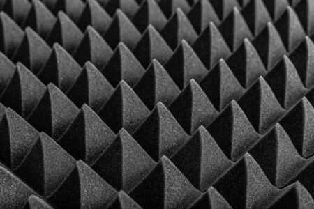 Abstract background in the form of pyramids and dragon scales. Acoustic black foam rubber. 版權商用圖片