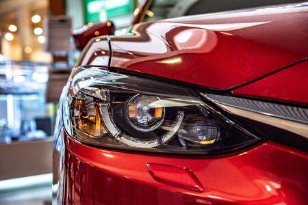 Modern car headlight close-up.