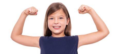 Little girl shows strength tensing muscles on white background. Stock fotó