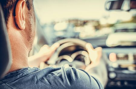 A man drives a car.