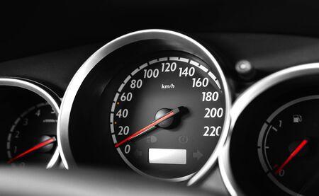 Car speedometer, close up.