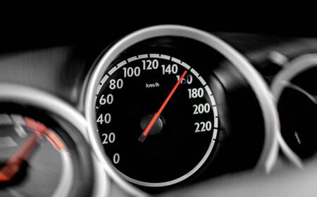 High speed on a car speedometer and motion blur.