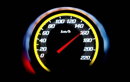 High speed on a car speedometer and motion blur. Stock Photo