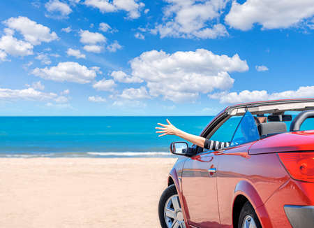 Red car on the beach. Vacation and freedom concept. Archivio Fotografico