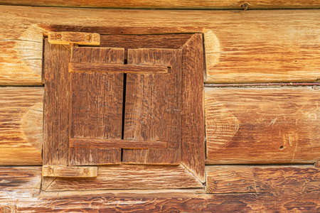 Old window of a wooden house.