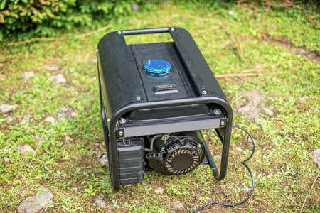 Portable gasoline generator in the open air. Stock fotó