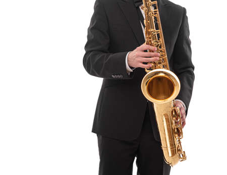 Saxophonist with a saxophone in his hands on a white.