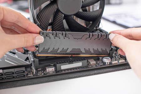 Installing random access memory into PC.