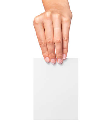 Female hand holds a white card isolated on white background.