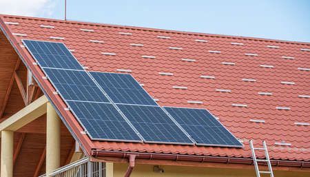 Solar panel power plant on the roof of house.