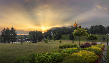 Beautiful sunset in Yaroslavl at the confluence of the Volga and Kotorosl with views of the Cathedral of the Assumption.