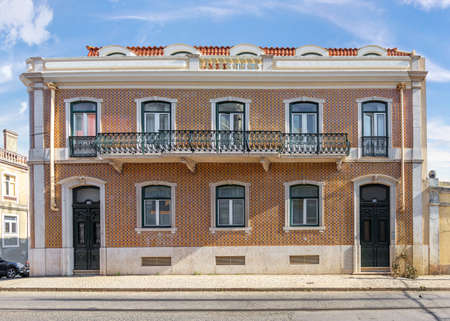 Residential building in Belem with beautiful wrought-iron balconies and decorated with traditional azulejo tiles. Lisbon, Portugal