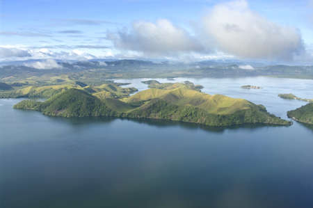 highlands region: Aerial photo of the coast of New Guinea with jungles and deforestation