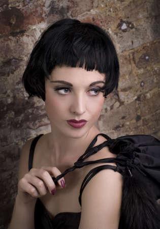 Beautiful woman on a background a brick wall  photo