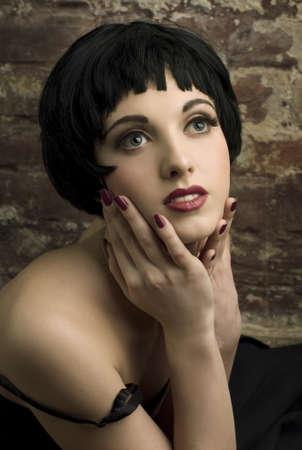 Beautiful woman on a background a brick wall Stock Photo - 9123224