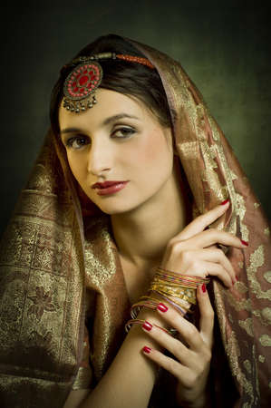 Beautiful brunette portrait with traditionl costume. Indian style
