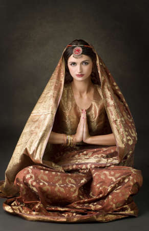 Beautiful indian brunette portrait with traditional costume Stock Photo - 9372875